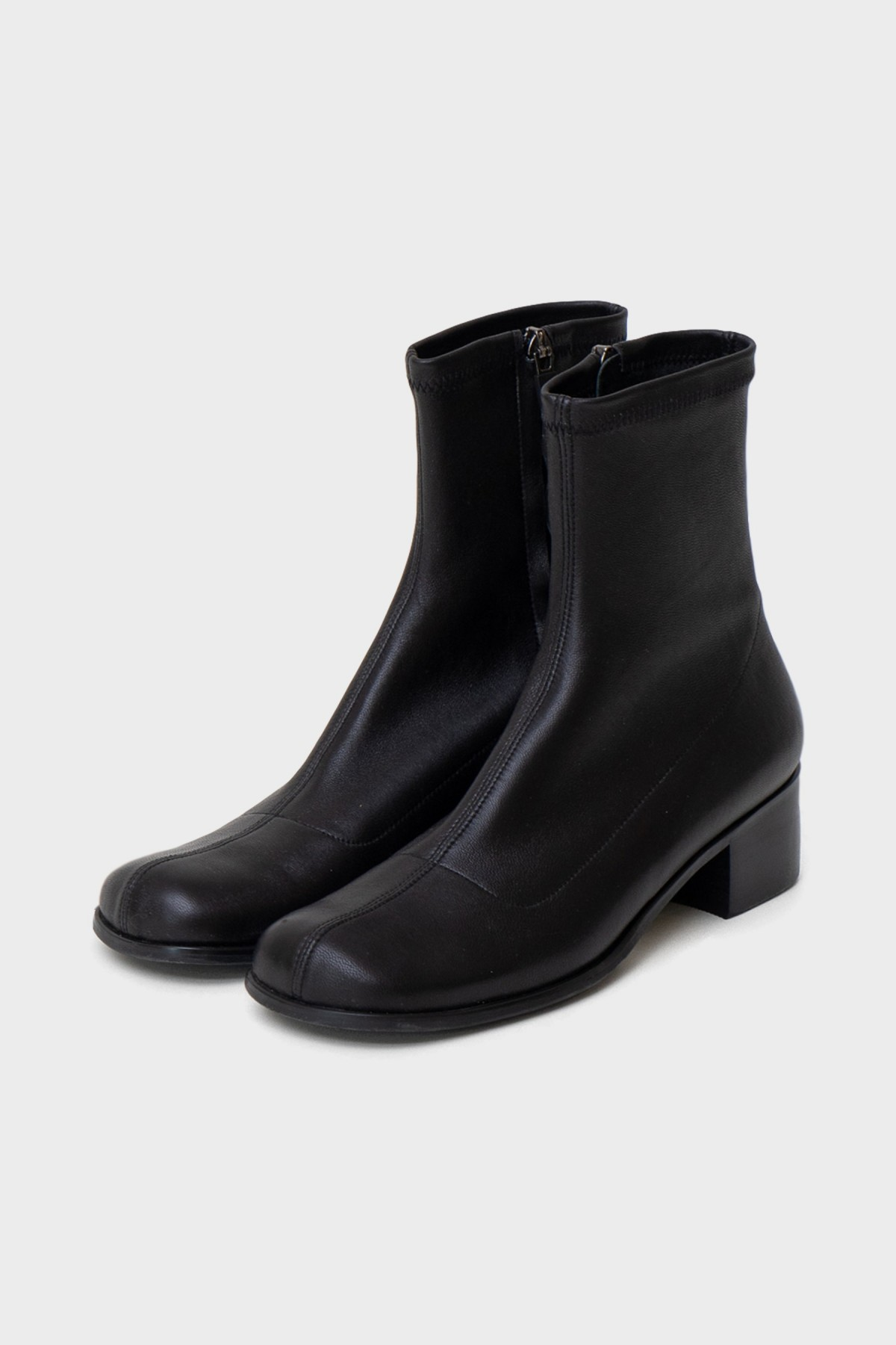 Amomento Slim Boots in Black